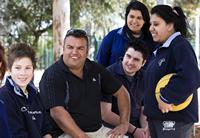 Teacher Corey Warrior with students