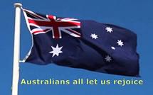 Australian flag flying with words underneath - 'Australians all let us rejoice'